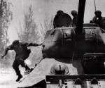 Cuba's leader Fidel Castro jumps from a tank as he arrives at Giron, Cuba, near the Bay Of Pigs.