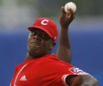 Yadier Pedroso pitched a complete game to lead Cuba over Holland.