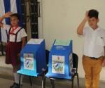 elecciones -3niños guardan