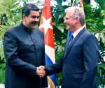 Cuban President Miguel Diaz-Canel shakes hands with Venezuela's President Nicolas Maduro at the Revolution Palace in Havana